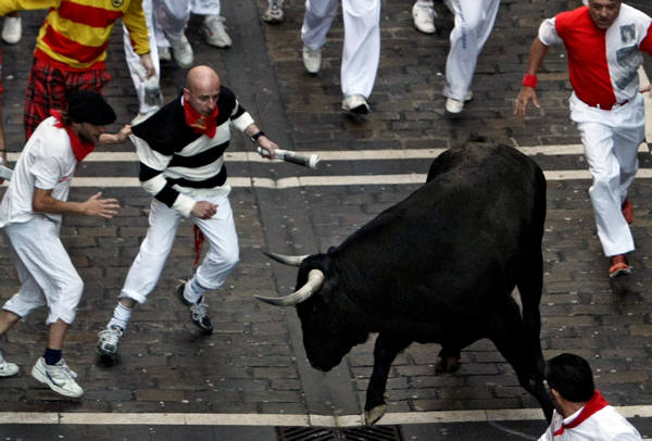 Revelers run next to Dolores Aguirre Ybarra ranch fighting bulls during the fourth running of the bulls at the San Fermin fiesta in Pamplona northern Spain, Saturday July 10, 2010. &#40;AP Photo&#47;Ivan Aguinaga&#41; <span class=meta>(AP Photo&#47;Ivan Aguinaga)</span>