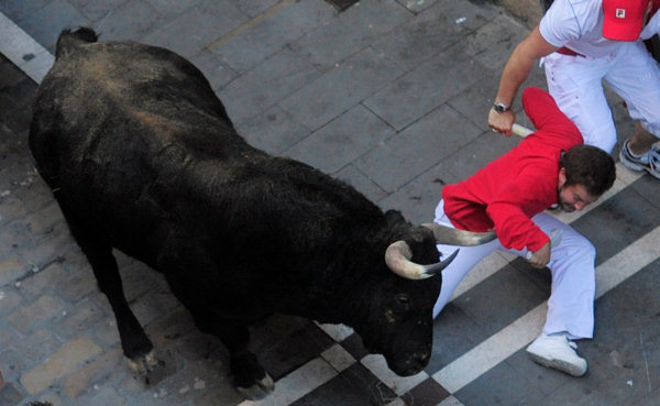 A Reveler runs in front of a El Pilar ranch fighting bulls during the San Fermin fiestas in Pamplona, Spain, Tuesday 13, 2010. &#40;AP Photo&#47;Manu Fernandez&#41; <span class=meta>(AP Photo&#47;Manu Fernandez)</span>