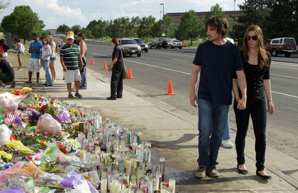 "<div class=""meta ""><span class=""caption-text "">Actor Christian Bale and his wife Sibi Blazic visit a memorial to the victims of Friday's mass shooting, Tuesday, July 24, 2012, in Aurora, Colo. Twelve people were killed when a gunman opened fire during a late-night showing of the movie ""The Dark Knight Rises,"" which stars Bale as Batman. (AP Photo/Ted S. Warren)</span></div>"