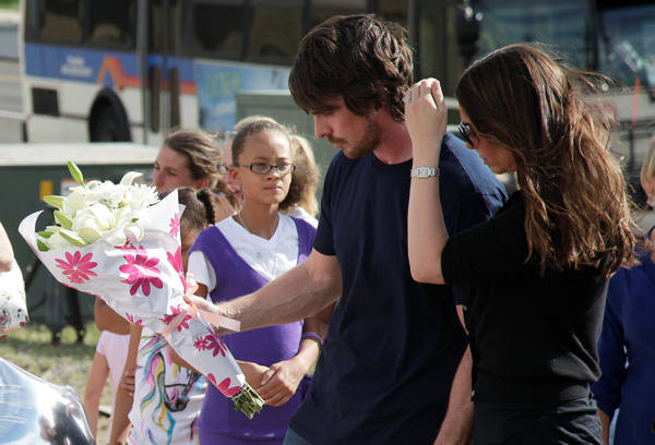 Actor Christian Bale and his wife Sibi Blazic visit a memorial to the victims of Friday&#39;s mass shooting, Tuesday, July 24, 2012, in Aurora, Colo. Twelve people were killed when a gunman opened fire during a late-night showing of the movie &#34;The Dark Knight Rises,&#34; which stars Bale as Batman. <span class=meta>(AP Photo&#47;Ted S. Warren)</span>