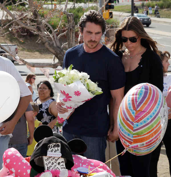 "<div class=""meta ""><span class=""caption-text "">Actor Christian Bale and his wife Sibi Blazic carry flowers as they visit a memorial to the victims of Friday's mass shooting, Tuesday, July 24, 2012, in Aurora, Colo. Twelve people were killed when a gunman opened fire during a late-night showing of the movie ""The Dark Knight Rises,"" which stars Bale as Batman. (AP Photo/Ted S. Warren)</span></div>"