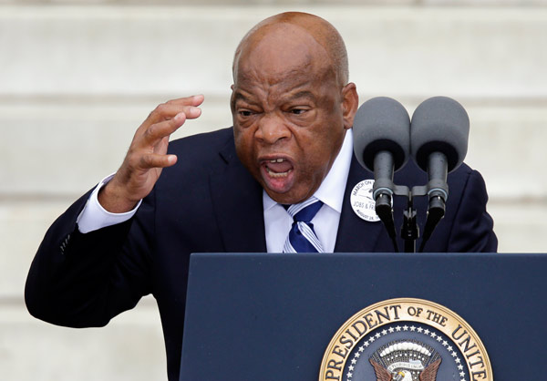 "Rep. John Lewis, D-Ga. speaks at the Let Freedom Ring ceremony at the Lincoln Memorial in Washington, Wednesday, Aug. 28, 2013, to commemorate the 50th anniversary of the 1963 March on Washington for Jobs and Freedom. It was 50 years ago today when Martin Luther King Jr. delivered his ""I Have a Dream"" speech from the steps of the memorial. (AP Photo/Carolyn Kaster)"