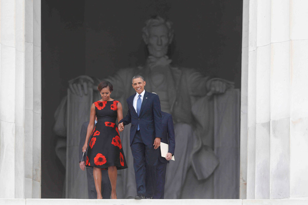 "<div class=""meta image-caption""><div class=""origin-logo origin-image ""><span></span></div><span class=""caption-text"">President Barack Obama and first lady Michelle Obama arrive at the 50th Anniversary of the March on Washington where Martin Luther King, Jr. spoke, Wednesday, Aug. 28, 2013, at the Lincoln Memorial in Washington. (AP Photo/Charles Dharapak)     </span></div>"