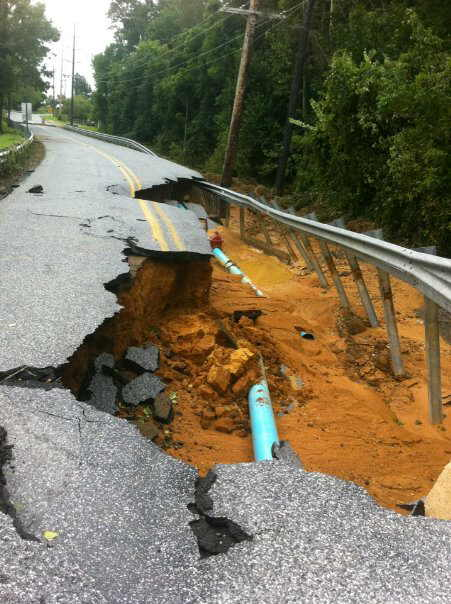 Massive damage to a section of East Lake Road in Woodstown, N.J. The floodwaters washed away the road and supporting ground, revealing pipes that were buried several feet beneath.