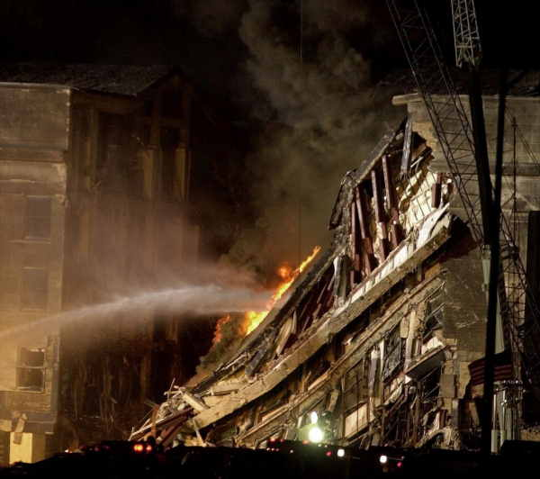 Firefighers spray water on a fire burning on the collapsed portion of Pentagon, Thursday, Sept. 13, 2001.  <span class=meta>(AP Photo&#47;Steve Helber)</span>