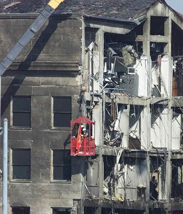 Marine Major Dan Pantaleo hangs from a crane in a basket after retrieving a Marine Corp flag from one of the offices as work continues on the damaged section of the Pentagon, Thursday, Sept. 13, 2001.  <span class=meta>(AP Photo&#47;Ron Edmonds)</span>