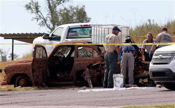 "<div class=""meta image-caption""><div class=""origin-logo origin-image ""><span></span></div><span class=""caption-text"">This Sept. 17, 2013, photo shows two cars recovered from Foss Lake, Okla. The Oklahoma State Medical Examiner's Office says authorities have recovered skeletal remains of multiple bodies in the Oklahoma lake where the two decades-old cars were pulled from the water by a dive team. (AP Photo/Daily Elk Citian, Laura Eastes)</span></div>"