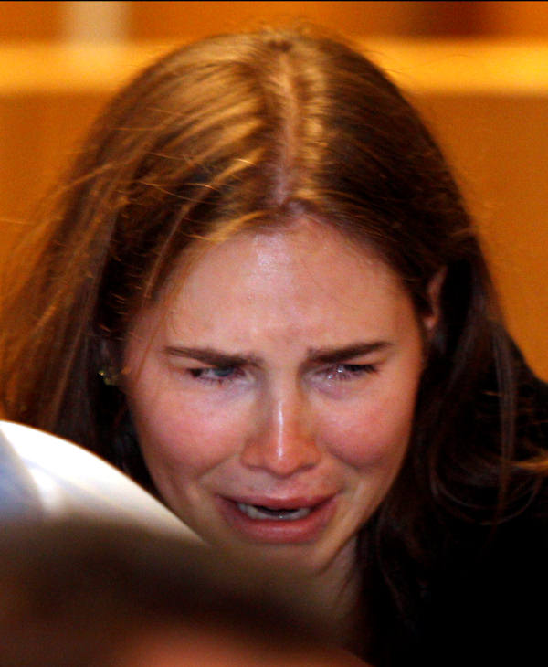 Amanda Knox breaks in tears after hearing the verdict that overturns her conviction and acquits her of murdering her British roommate Meredith Kercher, at the Perugia court, central Italy, Monday, Oct. 3, 2011. (AP Photo/Pier Paolo Cito)