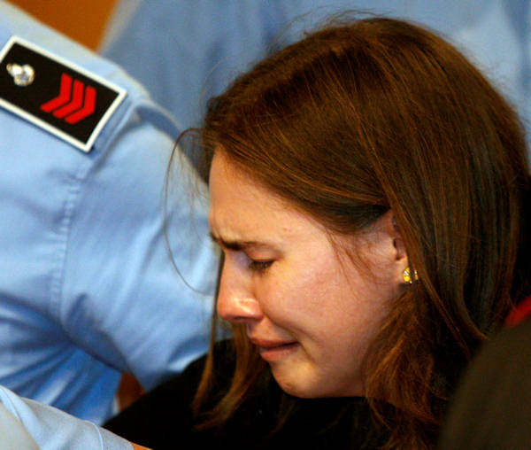 "<div class=""meta image-caption""><div class=""origin-logo origin-image ""><span></span></div><span class=""caption-text"">Amanda Knox breaks in tears after hearing the verdict that overturns her conviction and acquits her of murdering her British roommate Meredith Kercher, at the Perugia court, central Italy, Monday, Oct. 3, 2011. (AP Photo/Pier Paolo Cito)</span></div>"