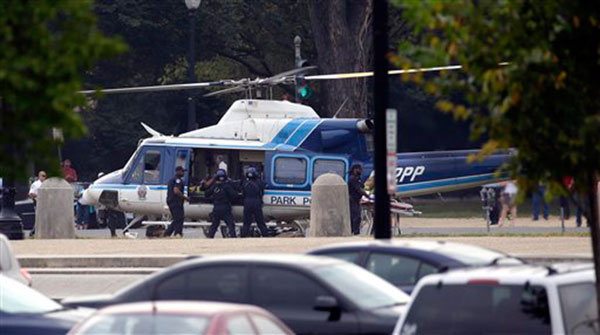 A U.S. Park Police helicopter is loaded on the Mall in Washington, Thursday, Oct. 3, 2013, with a victim from a shooting. Police say the U.S. Capitol has been put on a security lockdown amid reports of possible shots fired outside the building.  <span class=meta>(AP Photo&#47;Alex Brandon)</span>