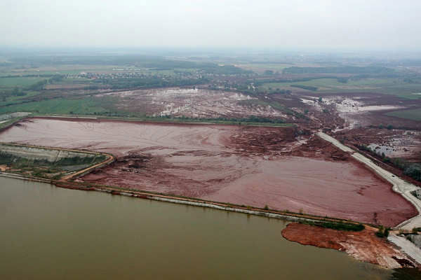 An aerial view of the broken dike, center right, of a reservoir containing red mud of an alumina factory near Ajka, 156 kms southwest of Budapest, Hungary, Tuesday, Oct. 5, 2010. The dike broke on Monday, and over one million cubic meters of the poisonous chemical sludge inundated three villages. The flood of toxic mud killed killed a yet unknown number of people, injured more than one hundred, with some people still missing.  <span class=meta>(AP Photo)</span>