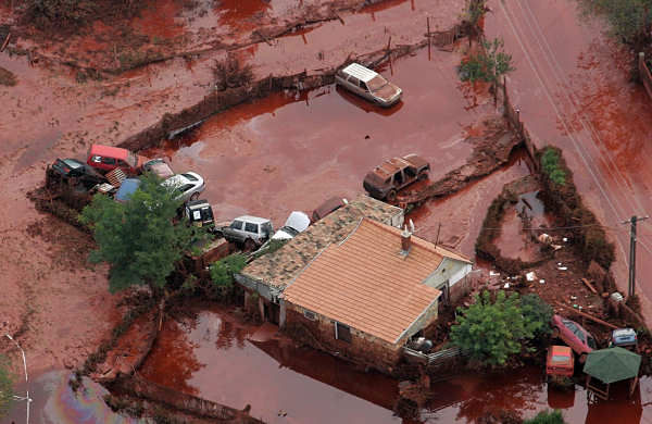 An aerial view shows overturned cars in the red sludge  yard of a house in Kolontar, 167 kms southwest of Budapest, Hungary, taken on Tuesday, Oct. 5, 2010, after the wall of a reservoir containing slurry from an alumina factory in nearby Ajka broke, and over one million cubic meters of the poisonous chemical sludge inundated three villages.  <span class=meta>(AP Photo)</span>