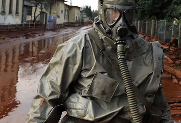 A Hungarian soldier wearing a chemical protection gear walks through a street flooded by toxic in the town of Devecser, Hungary, Tuesday, Oct. 5, 2010. Monday&#39;s flooding was caused by the rupture of a red sludge  reservoir at an alumina plant in western Hungary and has affected seven towns near the Ajkai Timfoldgyar plant in the town of Ajka, 100 miles &#40;160 kilometers&#41; southwest of Budapest.  <span class=meta>(AP Photo)</span>