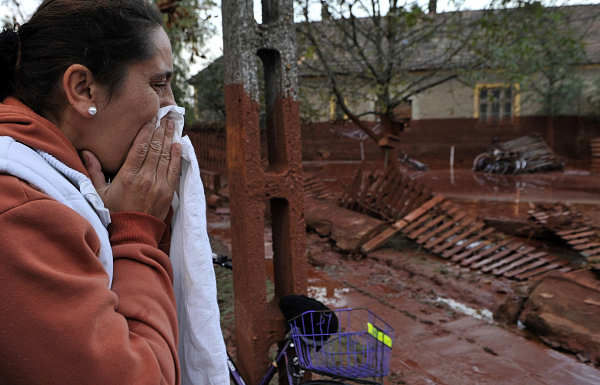 A Hungarian woman reacts while seeing her home flooded by toxic mud in the town of Devecser, Hungary, Tuesday, Oct. 5, 2010. Monday&#39;s flooding was caused by the rupture of a red sludge reservoir at an alumina plant in western Hungary and has affected seven towns near the Ajkai Timfoldgyar plant in the town of Ajka, 100 miles &#40;160 kilometers&#41; southwest of Budapest.  <span class=meta>(AP Photo)</span>