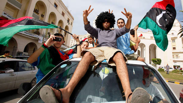 "<div class=""meta ""><span class=""caption-text "">Libyans react to Moammar Gadhafi's death in Tripoli, Libya, Thursday, Oct. 20, 2011. Libya's information minister said Moammar Gadhafi was killed Thursday when revolutionary forces overwhelmed his hometown, Sirte, the last major bastion of resistance two months after the regime fell. (AP Photo/Abdel Magid al-Fergany)</span></div>"