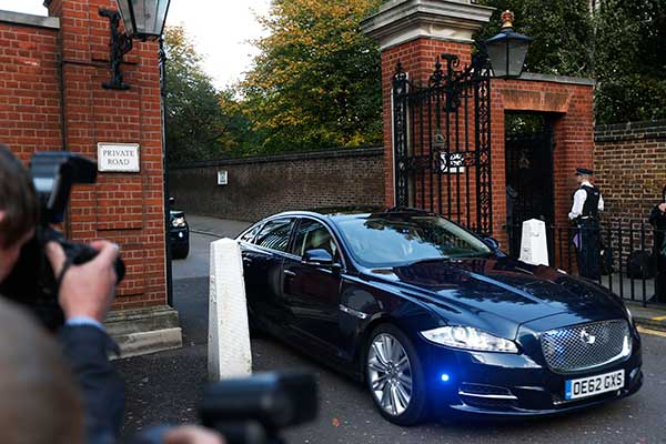 The car carrying Britain&#39;s Prince William, the Duchess of Cambridge and their son Prince George, leaves from Kensington Palace on the way to St. James Palace for the christening of Prince George. Britain&#39;s 3-month-old future monarch, Prince George will be christened Wednesday with water from the River Jordan at a rare four-generation gathering of the royal family in London. <span class=meta>(AP Photo&#47;Lefteris Pitarakis)</span>