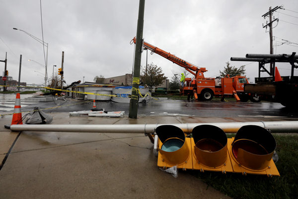 "<div class=""meta ""><span class=""caption-text "">Crews work to remove a damaged sign in the wake of superstorm Sandy, Tuesday, Oct. 30, 2012, in Philadelphia. Millions of people from Maine to the Carolinas awoke Tuesday without power, and an eerily quiet New York City was all but closed off by car, train and air as superstorm Sandy steamed inland, still delivering punishing wind and rain. (AP Photo/Matt Slocum)</span></div>"
