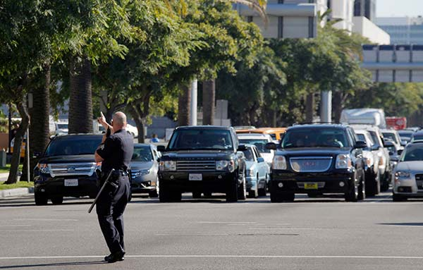 A police officer diverts traffic trying to enter the Los Angeles International Airport on Friday Nov. 1, 2013. Shots were fired Friday at Los Angeles International Airport, prompting authorities to evacuate a terminal and stop flights headed for the city from taking off from other airports.  <span class=meta>(AP Photo&#47;Nick Ut)</span>