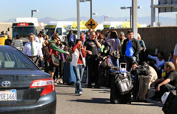 Passengers evacuate the Los Angeles International Airport on Friday Nov. 1, 2013, in Los Angeles. Shots were fired at Los Angeles International Airport, prompting authorities to evacuate a terminal and stop flights headed for the city from taking off from other airports. <span class=meta>(AP Photo&#47;Ringo H.W. Chiu)</span>