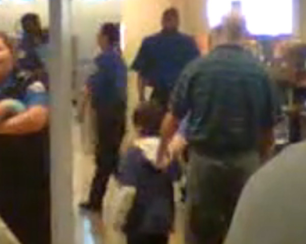 A 39 second clip, shot on a cell phone camera at Salt Lake International Airport on Friday, shows a young boy with his shirt off and TSA officials, with gloves, patting him down.   Watch the YouTube clip here.  <span class=meta>(Luke Tait&#47;YouTube)</span>
