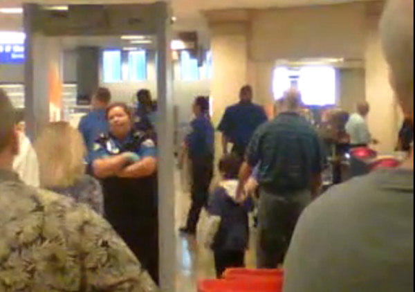 "<div class=""meta image-caption""><div class=""origin-logo origin-image ""><span></span></div><span class=""caption-text"">A 39 second clip, shot on a cell phone camera at Salt Lake International Airport on Friday, shows a young boy with his shirt off and TSA officials, with gloves, patting him down.   Watch the YouTube clip here.  (Luke Tait/YouTube)</span></div>"