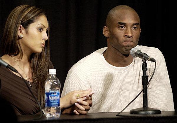 Los Angeles Lakers star Kobe Bryant holds the hand of his wife Vanessa as he pauses during a news conference Friday, July 18, 2003, at the Staples Center in Los Angeles. Bryant was charged Friday with sexually assaulting a 19-year-old woman in a case bound to tarnish the career of one of the NBAs brightest young superstars. Bryant denied the charge, saying he was guilty only of adultery. <span class=meta>(AP Photo&#47;Kevork Djansezian)</span>