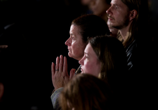 Residents look on during an interfaith vigil for the victims of the Sandy Hook Elementary School shooting on Sunday, Dec. 16, 2012, at Newtown High School in Newtown, Conn. A gunman walked into the elementary school Friday and opened fire, killing 26 people, including 20 children. President Barack Obama is schedule to speak during the vigil.  <span class=meta>(AP Photo&#47; Evan Vucci)</span>