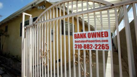A bank owned sign is seen on a home that is listed as a foreclosure  on a HUD website, in Hawthorne, Calif., Wednesday, July 21, 2010.
