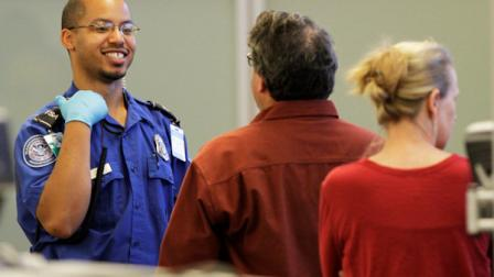 A TSA agent waits for approval to release travelers as they go through airport security at the screening area of the Richmond International airport in Richmond, Va., Tuesday, Nov. 23, 2010.  (AP Photo/Steve Helber)