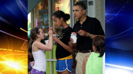 FILE - In this Dec. 27, 2010 file photo, President Barack Obama, right, his daughter Malia, second from right, and family and friends eat Shave Ice at Island Snow at Kailua Beach Center while on vacation with the first family in Kailua, Hawaii. (AP Photo/Carolyn Kaster, File)