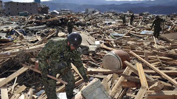 Japan upgrades magnitude of killer quake to 9.0
