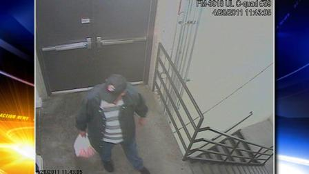 This April 20, 2011 image taken from surveillance video provided by the FBI shows person of interest sought in a fire and the planting of a pipe bomb and two propane tanks near a food court at the Southwest Plaza Mall in Littleton, Colo.