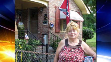 Annie Chambers Caddell stands outside her home in Summerville, S.C., on Thursday, Oct. 14, 2010. The Confederate flag behind her has raised concern in her predominantly black neighborhood, and neighbors plan a protest march.