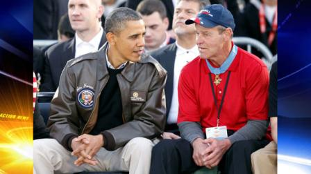 President Barack Obama talks with Medal of Honor recipient John Baca before the start of the Carrier Classic NCAA basketball game between North Carolina and Michigan State on the flight deck of the USS Carl Vinson in Coronado, Calif., Friday, Nov. 11, 2011. (AP Photo/Susan Walsh)