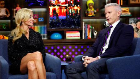 COMMERCIAL IMAGE - In this photograph taken by AP Images for Bravo, reality star Camille Grammer and TV personality Anderson Cooper appear on Bravos Watch What Happens Live show on Monday, Jan. 9, 2012, in New York. (Peter Kramer/AP Images for Bravo