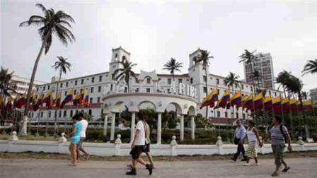 People walk past Hotel El Caribe in Cartagena, Colombia, Saturday April 14, 2012. The Secret Service sent home some of its agents for misconduct that occurred at the hotel before President Barack Obamas arrival on Friday for the Summit of the Americas. (AP Photo/Fernando Vergara)