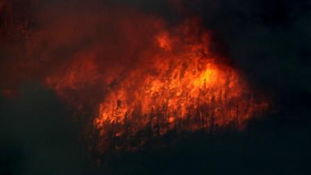 Fire explodes on the south side of Poudre Canyon as the High Park wildfire burns west of Fort Collins, Colo., on Thursday, June 14, 2012. The wildfire started Saturday and has burned over 50,000 acres. (AP Photo/Ed Andrieski)