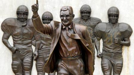 This is the statue of former Penn State University head football coach Joe Paterno that stands outside Beaver Stadium in State College, Pa., Friday, July 13, 2012. (AP Photo/Gene J. Puskar)