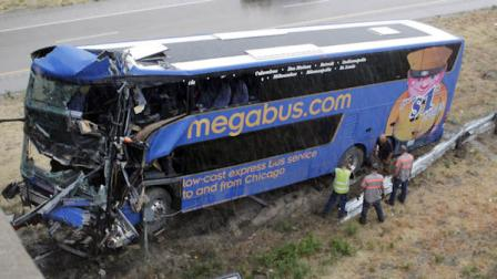 The wreckage of a Megabus is removed from the bridge support pilar that it slammed into after blowing a tire, Thursday, Aug. 2, 2012 in Litchfield, Ill. Illinois State Police Trooper Doug Francis said at least one person was killed in the afternoon wreck which was traveling from Chicago to Kansas City. He didnt immediately have other details about the death. (AP Photo/Tom Gannam)