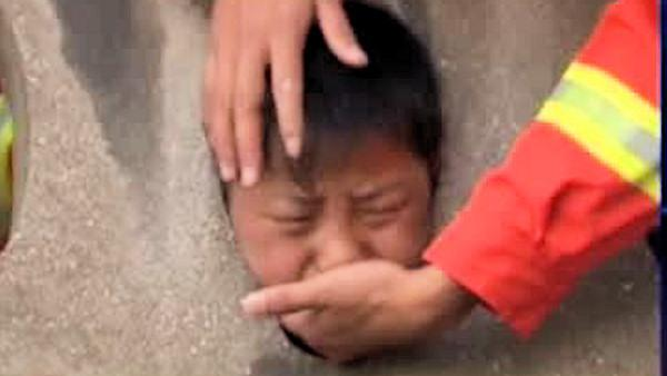 Boy gets head stuck in concrete wall