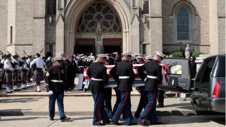 A Marine honor guard carries the casket of Lance Cpl. Greg Buckley Jr. out of St. Agnes Cathedral after his funeral Mass, Saturday, Aug. 18, 2012 in Rockville Center, N.Y.. Buckley Jr. was barely 21 years old when he was killed in an attack by a policeman in Afghanistan. (AP Photo/Mary Altaffer)
