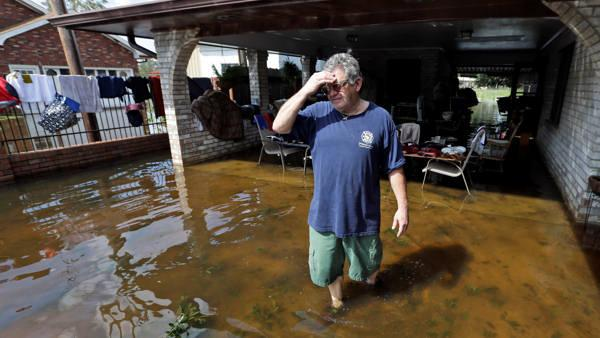 Days after Isaac, flooding and outages remain