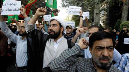Iranian protestors chant slogans during a demonstration against a film ridiculing Islams Prophet Muhammad, in front of Swiss Embassy in Tehran, which represents US interests in Iran, Thursday, Sept. 13, 2012.  (AP Photo/Vahid Salemi)