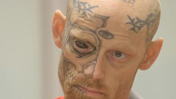Police: Man with tattooed eye shot at officers
