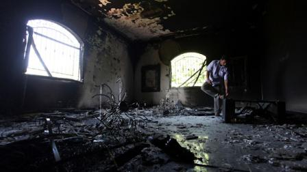 A Libyan man investigates the inside of the U.S. Consulate, after an attack that killed four Americans, including Ambassador Chris Stevens on the night of Tuesday, Sept. 11, 2012, in Benghazi, Libya, Thursday, Sept. 13, 2012. (AP Photo/Mohammad Hannon)