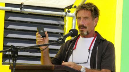 In this Thursday Nov. 8, 2012 photo software company founder John McAfee speaks at the official presentation of equipment ceremony that took place at the San Pedro Police Station in Ambergris Caye, Belize.  (AP Photo/Ambergris Today Online-Sofia Munoz)