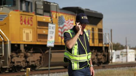 A railroad investigator talks on the phone at the scene of an accident where four veterans were killed and 16 other people were injured when a train slammed into a parade float carrying the returning heroes to a banquet last Thursday in Midland, Texas on Saturday, Nov. 17, 2012. Federal investigators were trying to determine whether the two-float parade had been given enough warning to clear the tracks. (AP Photo/Juan Carlos Llorca)