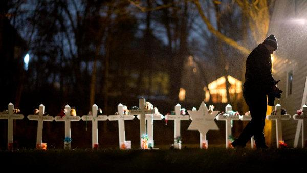 Community on edge as classes resume in Newtown