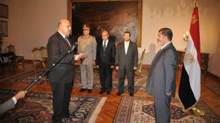 Egyptian President Mohammed Morsi swears in a newly-appointed vice president, former senior judge, Mahmoud Mekki, in Cairo, Egypt Sunday, Aug. 12, 2012. Egypts Islamist president also ordered his defense minister and chief of staff to retire on Sunday and canceled the military-declared constitutional amendments that gave top generals wide powers. (AP Photo/Egyptian Presidency)