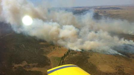 In this photo provided by the New South Wales Rural Fire Service, plumes of smoke rise from a fire near Cooma, Australia, Tuesday, Jan. 8, 2013. Temperatures across much of New South Wales state are expected to reach 45 degrees Celsius (113 degrees Fahrenheit) causing extreme conditions. (AP Photo/New South Wales Rural Fire Service)